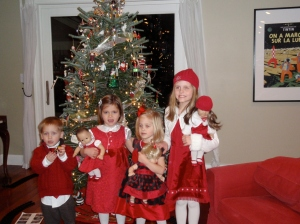 later on Christmas Eve we caught up with the cousins...all the girls dressed as their dolls...it's a good thing we had a boy just to give Oskar a little solidarity!